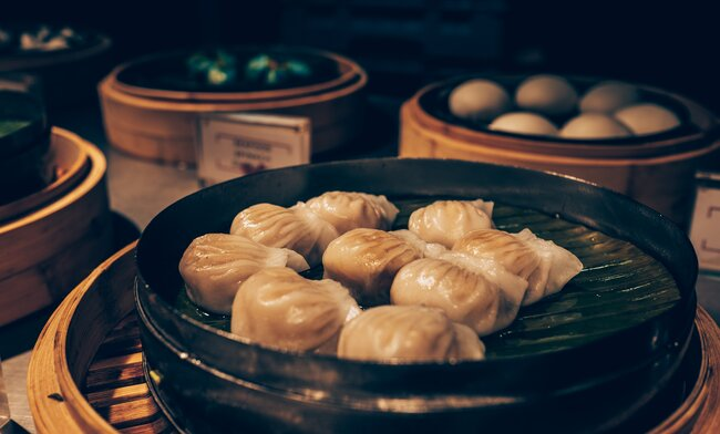 Yum cha table with dumplings and steamed buns