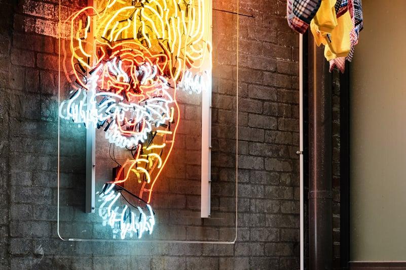 Neon tiger sign at Harry's Dumpling Houe