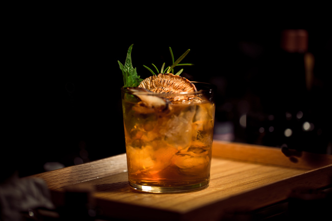 Cocktail sitting on wooden tray