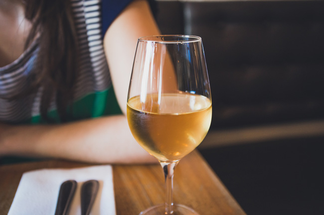 Glass of white wine on the table