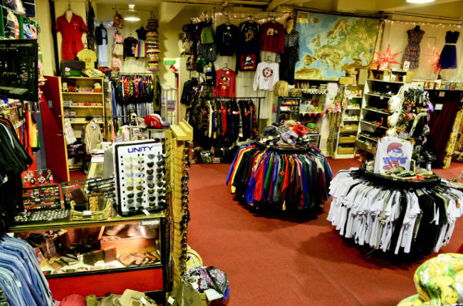 an op shop filled with clothing and accesories