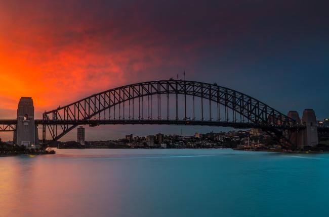 the Sydney harbour bridge as the sun sets