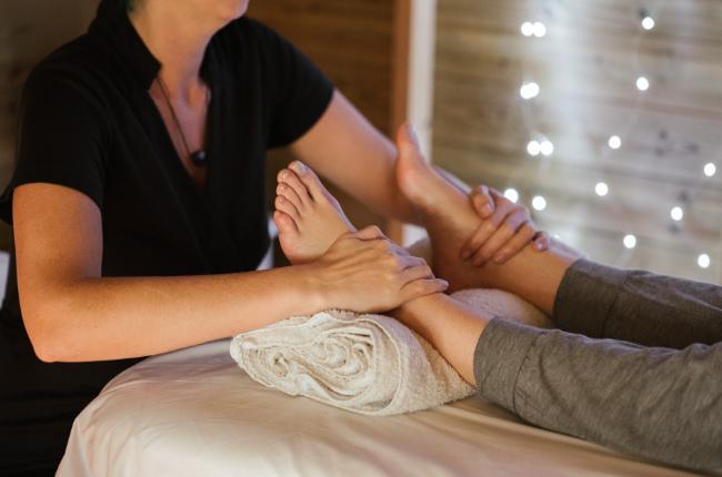 a woman getting a foot massage