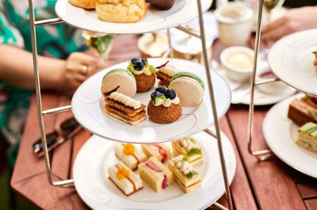 a selection of sandwiches and sweets on a table