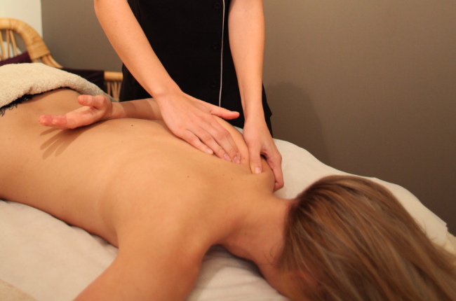 a woman getting a shoulder blade massage