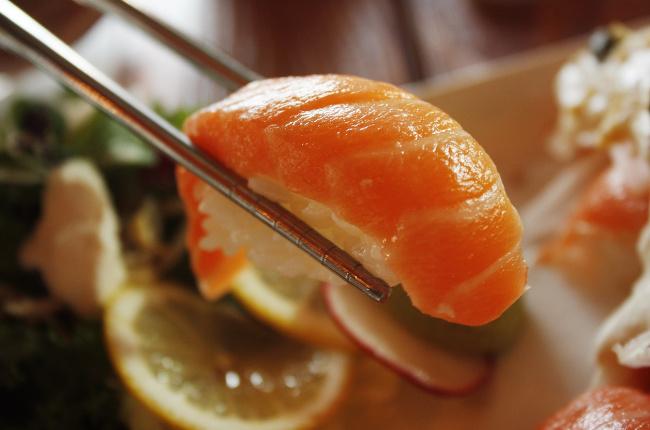 a close up shot of fresh sashimi sushi