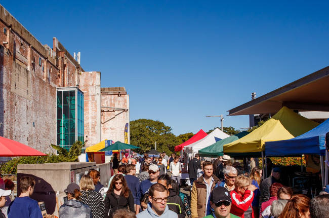 a crowd enjoying jam powers markets on a sunny day