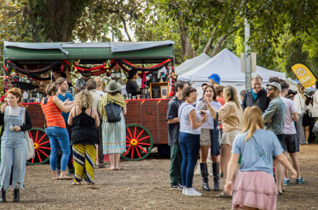 a crowd of people enjoying west end markets